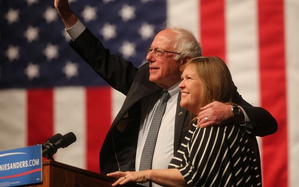 Democratic presidential candidate Sen. Bernie Sanders, I-Vermont, waves to the crowd with his wife, Jane Sanders, during a campaign rally at the University of Wyoming in Laramie, Wyoming, on April 5, 2016. (Blaine McCartney/The Wyoming Tribune Eagle via AP)