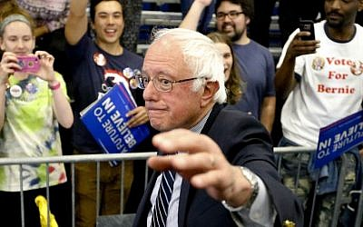 Democratic presidential candidate Sen. Bernie Sanders, I-Vt., waves as he leaves a campaign rally at Fitzgerald Fieldhouse on the University of Pittsburgh campus, Monday, April 25, 2016, in Pittsburgh. (AP/Keith Srakocic)