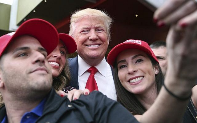 Supporter Pat Montelli, left, and friend Catherine Freeman, right, take a photograph with Republican presidential candidate Donald Trump at a campaign rally Sunday, April 17, 2016, in the Staten Island borough of New York. (AP/Mel Evans)