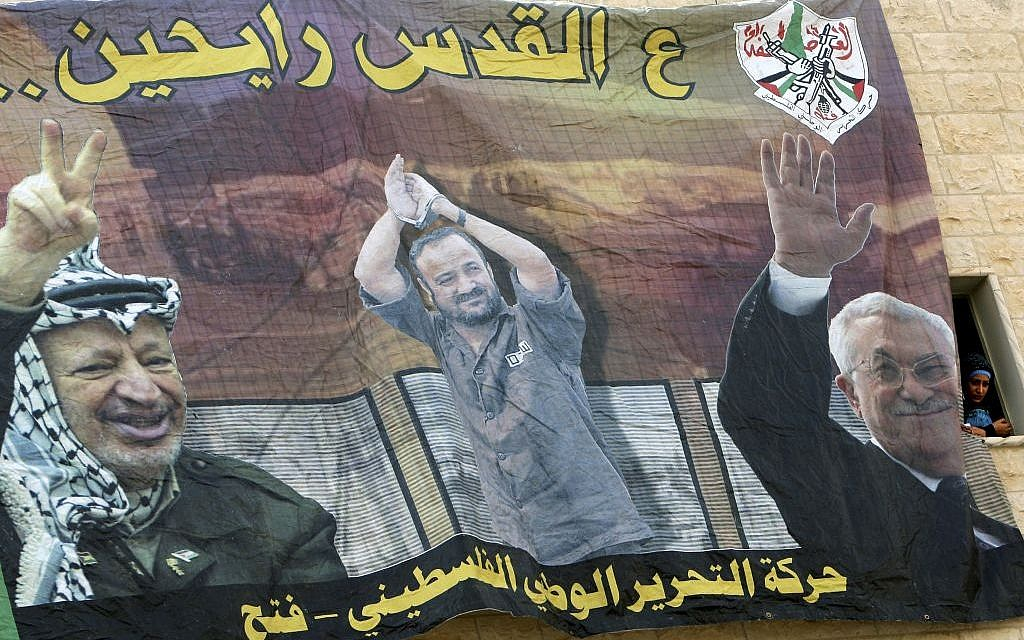 "A poster at Al-Quds University in the West Bank city of Jenin shows, from left, Yasser Arafat, jailed Palestinian Marwan Barghouti and Mahmoud Abbas and reads: ""Going to Jerusalem"". (AP /Mohammed Ballas)"