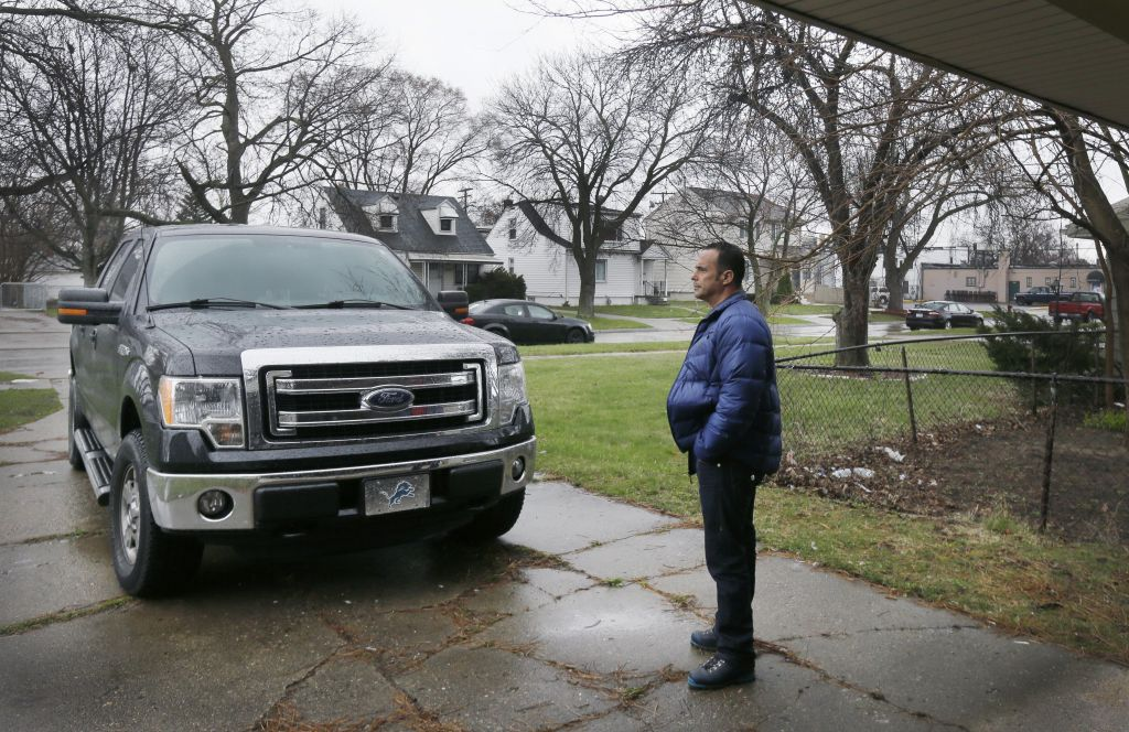 Nedal Tamer stands outside a house he is renovating in Dearborn, Mich. Tamer feels that, as a supporter of Donald Trump's bid for the presidency, he is in the minority among Muslim Americans. He's comfortable with his position, yet a little confounded that he doesn't have more company. (AP Photo/Carlos Osorio)