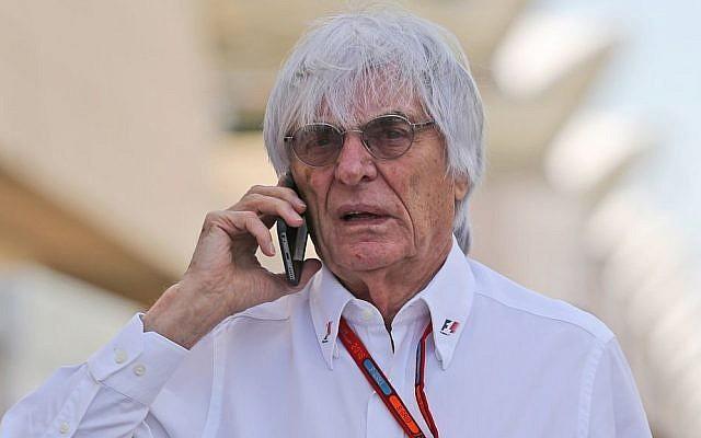 Bernie Ecclestone, chief executive of the Formula One Group talks on his mobile phone ahead of the Bahrain Formula One Grand Prix at the Formula One Bahrain International Circuit, in Sakhir, Bahrain, Sunday, April 3, 2016. (AP Photo/Kamran Jebreili)