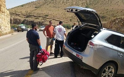 Medical emergency services surround a car after a crash in the Jordan Valley on April 24, 2016. (MDA)