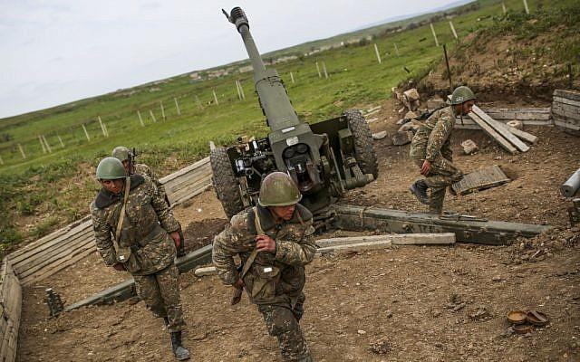 Nagorno-Karabakh army artillerymen prepare to open fire from a howitzer on positions in Nagorno-Karabakh, Azerbaijan, April 5, 2016. (Vahan Stepanyan/PAN via AP)