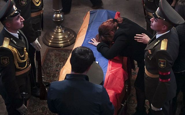 Mother of Karabakh military officer Armenak Urfanyan grieves at a coffin with the body of her son who was killed in fighting around Nagorno-Karabakh, during a funeral ceremony in a church in Yerevan, Armenia, April 5, 2016. (Aram Kirakosyan/PAN via AP)