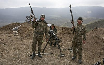 Armenian soldiers pose near a frontline in Nagorno-Karabakh, Azerbaijan, April 6, 2016. (Karo Sahakyan/PAN via AP)