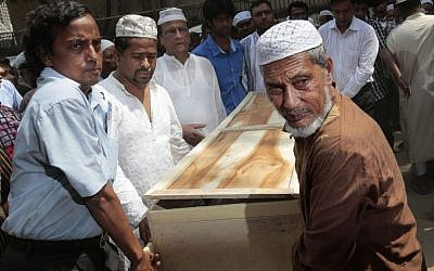 Bangladeshi Muslims carry the body of Xulhaz Mannan, who was stabbed to death by unidentified assailants, to his funeral in Dhaka, Bangladesh, Tuesday, April 26, 2016. (AP Photo)