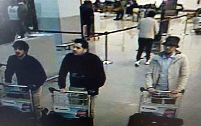 This image provided by the Belgian Federal Police shows three men who took part in the March 22, 2016 attacks at Belgium's Zaventem Airport. The man on the right is as yet unidentified. The man on the left was named as Najim Laachraoui and the man in the center as Ibrahim El Bakraoui. (Belgian Federal Police via AP)