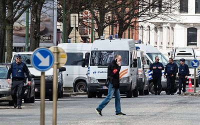 Police secure an area during a house search in the Etterbeek neighborhood in Brussels, April 9, 2016. (AP Photo/Geert Vanden Wijngaert)