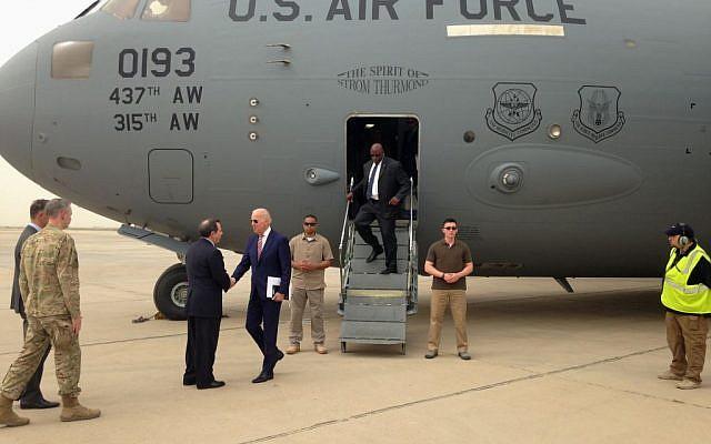 US Vice President Joe Biden is greeted by US Ambassador Stuart Jones after stepping off a C-17 military transport plane upon his arrival in Baghdad, Iraq, April 28, 2016. (AP/Josh Lederman)
