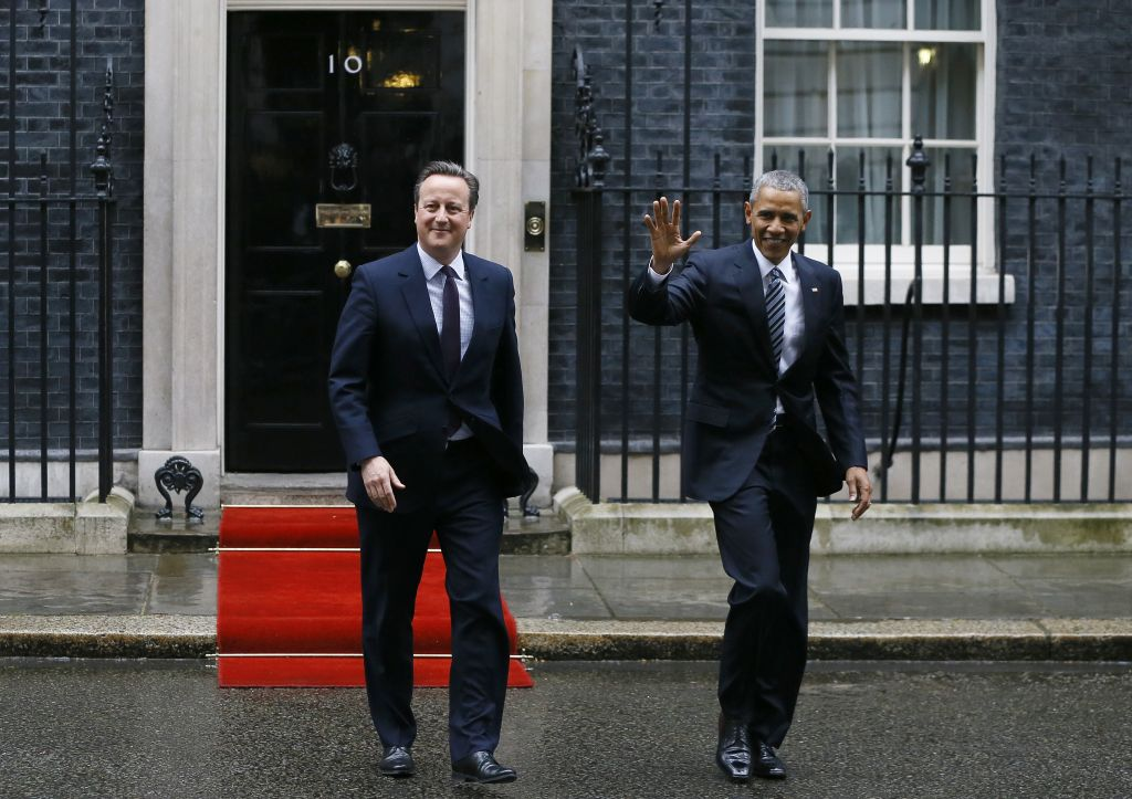 U.S President Barack Obama, right, and Britain's Prime Minister David Cameron walk from 10