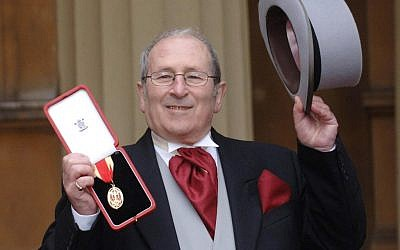 British playwright Arnold Wesker poses at Buckingham Palace, London, after being knighted, February 22, 2006. (Stefan Rousseau/PA via AP)
