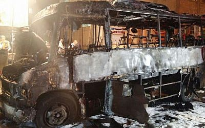 A minibus in Bnei Brak that went up in flames on April 27, 2016. (Israel Police)