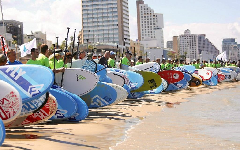 Paddle-boarders lining up for Tel Aviv's now-annual seaside competition, taking place this year on Thursday, April 28 (Courtesy Efrat Saar)