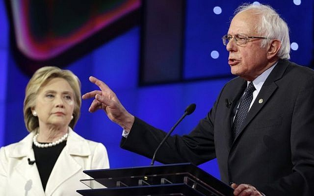 Democratic presidential candidate Sen. Bernie Sanders, right, speaks as Hillary Clinton listens during the CNN Democratic Presidential Primary Debate at the Brooklyn Navy Yard on Thursday, April 14, 2016 in New York. (AP Photo/Seth Wenig)