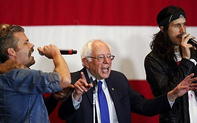 Democratic presidential candidate Sen. Bernie Sanders, I-Vt., sings during a campaign event, Monday, April 4, 2016, in Milwaukee. (AP Photo/Paul Sancya)