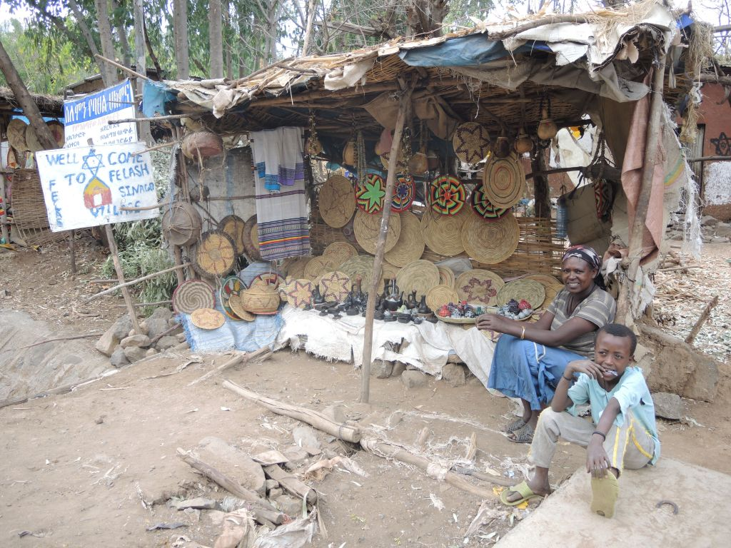 A resident and her son in their tourism stall at the entrance of Wolleka village, an abandoned Jewish village in Gondar, Ethiopia, that has become a tourism destination, on April 24, 2016. (Melanie Lidman/Times of Israel)