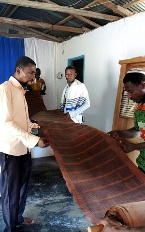 The community has a leather Torah, though they generally read a translation of the week's portion in Twi, the lengua franca of Ghana. (Melanie Lidman/Times of Israel)