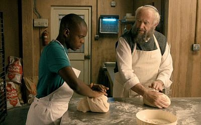 Jonathan Pryce (right) as a Jewish baker, and Jerome Holder as his apprentice in 'Dough' (Menemsha Films)