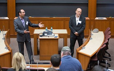During an April 3, 2016 conference at Harvard University, keynote speakers Ala Sader (left) and Gai Hetzroni discuss Israeli-Palestinian economic ties (Elan Kawesch/The Times of Israel)