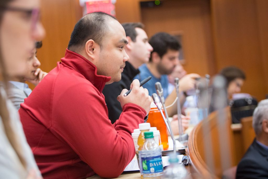 During an April 3, 2016 conference at Harvard University, participants listen to keynote speakers Ala Sader (left) and Gai Hetzroni discuss Israeli-Palestinian economic ties (Elan Kawesch/The Times of Israel)
