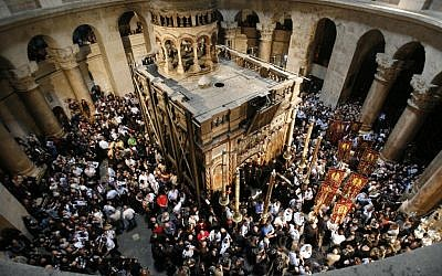 Orthodox Christians hold candles as worshipers gather around the Edicule at the Church of the Holy Sepulcher, traditionally believed to be the burial place of Jesus Christ, during the ceremony of the Holy Fire in Jerusalem's Old City, April 7, 2007. (Nati Shohat /Flash90)