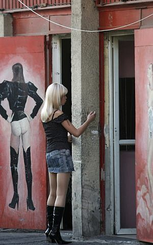 A young woman stands outside a brothel in south Tel Aviv. Sep 21, 2008.(Kobi Gideon / FLASH90)