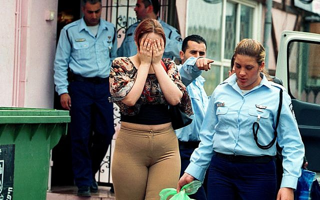 The migration police during the deportation of Eastern European prostitutes near Haifa. (Moshe Shai/Flash90)