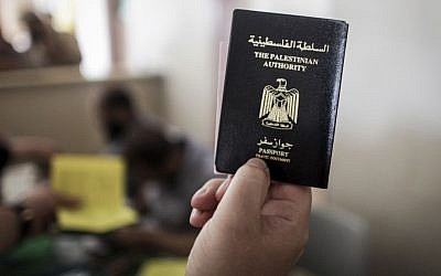 A Palestinian man at the Rafah border crossing holds his Palestinian Authority issued passport  on June 12, 2015. (Aaed Tayeh/Flash90)