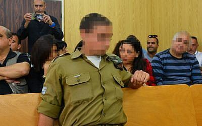 An Israeli soldier who shot a Palestinian assailant in Hebron sits in a military court hearing in Tel Aviv, April 5, 2016. (Flash90)