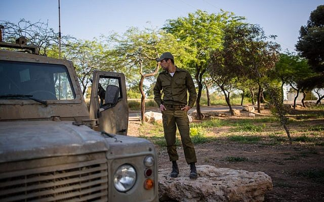 An Israeli soldier seen next to a patrol jeep near the northern Gaza Strip on April 7, 2016. (Corinna Kern/Flash90)