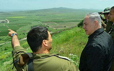 Prime Minister Benjamin Netanyahu tours the Golan Heights near the Syrian border, April 11, 2016. (Kobi Gideon/GPO)