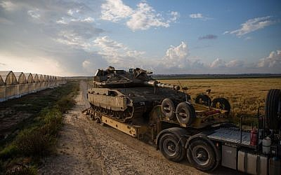 A tank is transported near Kibbutz Be'eri just outside the central Gaza Strip on April 13, 2016. (Corinna Kern/Flash90)