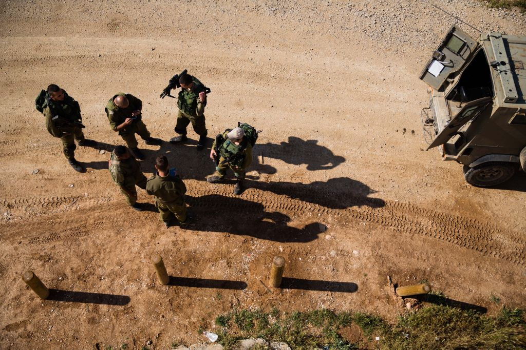 Israeli soldiers patrol just outside the central Gaza Strip on April 13, 2016 (Corinna Kern/Flash90)