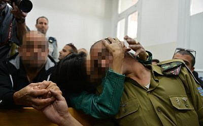 The Israeli soldier who shot a Palestinian terrorist in Hebron arrives for a court hearing at a military court in Jaffa, April 14, 2016. (Flash90)