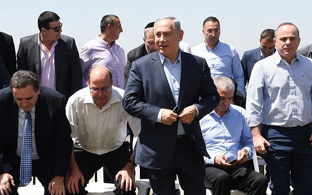 Prime Minister Benjamin Netanyahu with his government at the weekly cabinet meeting, held in the Golan Heights, on April 17, 2016. (Effi Sharir/Pool)