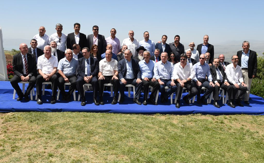 Israeli Prime Minister Benjamin Netanyahu poses for a group picture with his government at the weekly cabinet meeting, held in the Golan Heights on April 17, 2016. (Effi Sharir/POOL)
