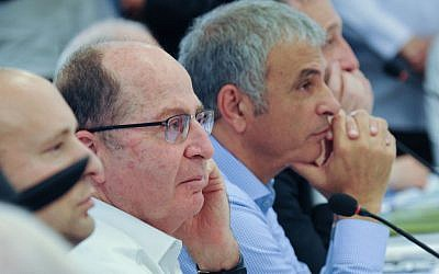 Defense Minister Moshe Ya'alon attends the weekly cabinet meeting, which was held on the Golan Heights, April 17, 2016. (Meir Vaknin/Pool)