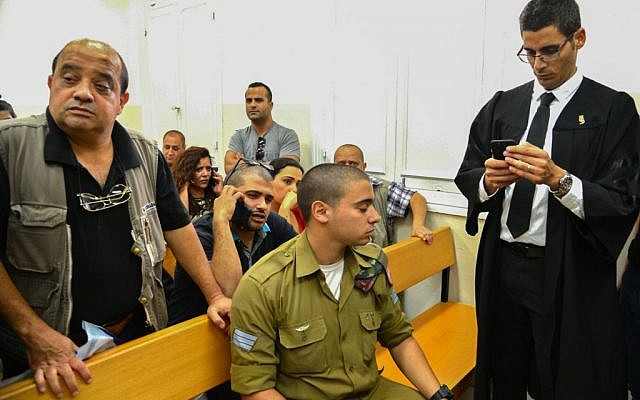 Sgt. Elor Azaria, accused of killing a disarmed Palestinian attacker in Hebron last month, arrives for a court hearing at Jaffa Military Court on April 18, 2016. (Flash90)