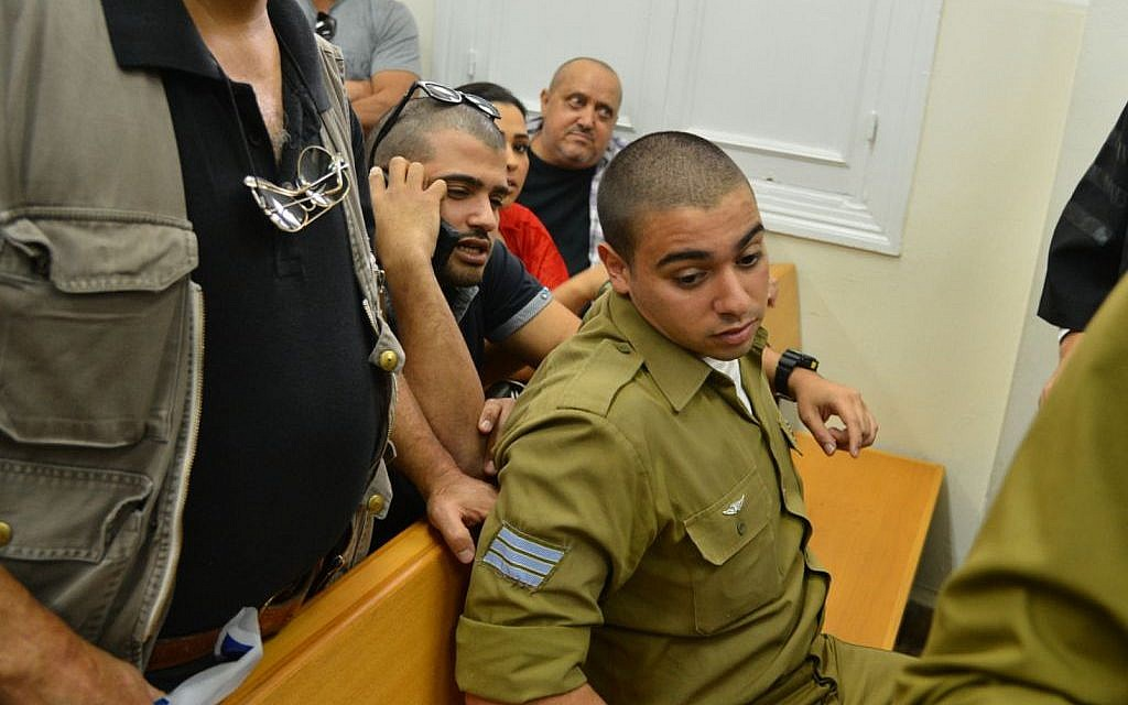 Sgt. Elor Azaria, the Israeli soldier who shot dead a disarmed Palestinian terrorist in Hebron last month, arrives for a court hearing at Jaffa Military Court on April 18, 2016. (Photo by Flash90)
