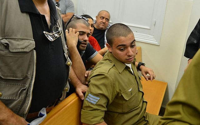 Sgt. Elor Azaria, the Israeli soldier who shot dead a disarmed Palestinian terrorist in Hebron last month, arrives for a court hearing at Jaffa Military Court on April 18, 2016. (Flash90)