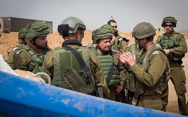 IDF Chief of Staff Gadi Eisenkot, center, and head of the Southern Command, Maj. Gen. Eyal Zamir, left, inspect a newly discovered 'terror tunnel,' believed to have been dug by Hamas terrorists from the Gaza Strip into southern Israel, on April 18, 2016. (IDF Spokesperson/FLASH90)