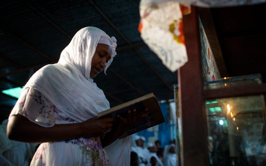 A member of the Falash Mura Jewish Ethiopian community lights the Sabbath candles before the Sabbath and Passover prayer service  in the synagogue in Gondar, Ethiopia, April 22, 2016. (Miriam Alster/FLASH90)