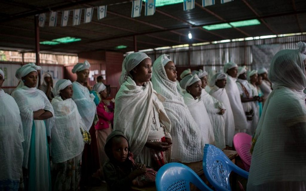 Members of the Falash Mura Jewish Ethiopian community wait for prayer service before attending the Passover seder meal, in the synagogue in Gondar, Ethiopia, April 22, 2016 (Miriam Alster/FLASH90)