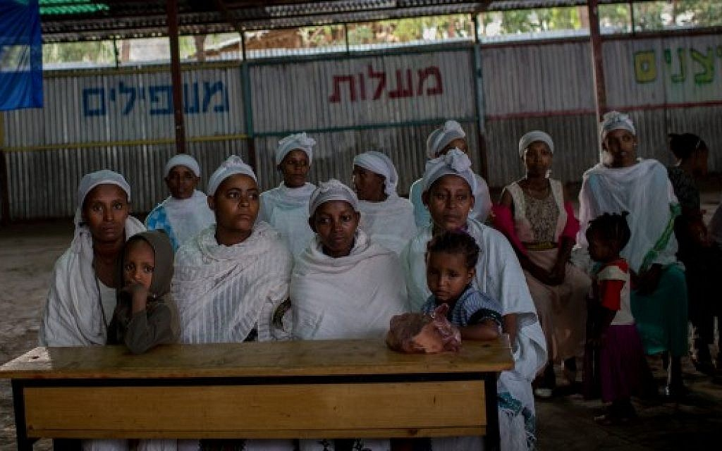 Members of the Falash Mura Jewish Ethiopian community wait for prayer service before attending the Passover seder meal, in the synagogue in Gondar, Ethiopia, April 22, 2016. (Miriam Alster/FLASH90)