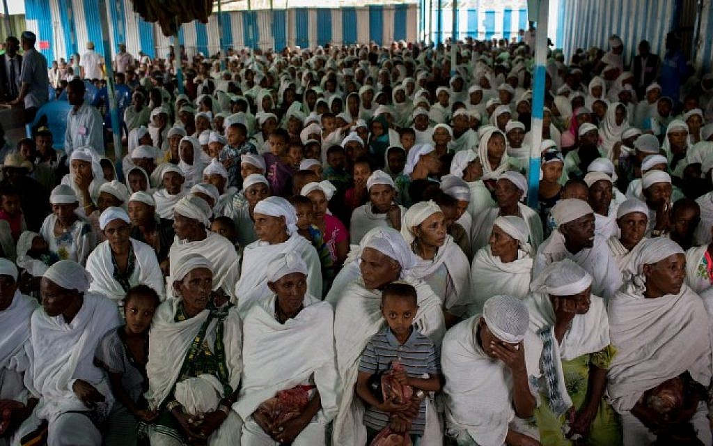 Members of the Jewish Ethiopian community wait for prayer service before attending the Passover seder meal, in the synagogue in Gondar, Ethiopia, April 22, 2016. (Miriam Alster/FLASH90)