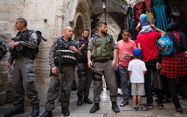 Israeli police officers guard at an entrance to the Al Aqsa Mosque on the Temple Mount in Jerusalem's Old City, during the Jewish holiday of Passover, on April 24, 2016. (Corinna Kern/Flash90 )