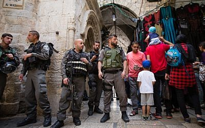 Israeli police officers guard an entrance to the Al-Aqsa Mosque and Temple Mount in Jerusalem's Old City during the Jewish holiday of Passover, on April 24, 2016. (Corinna Kern/Flash90)