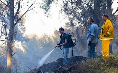 Israeli fire fighters work to extinguish a forest fire in Biriya Forest, near Safed in northern Israel, April 25, 2016. (Basel Awidat/Flash90)