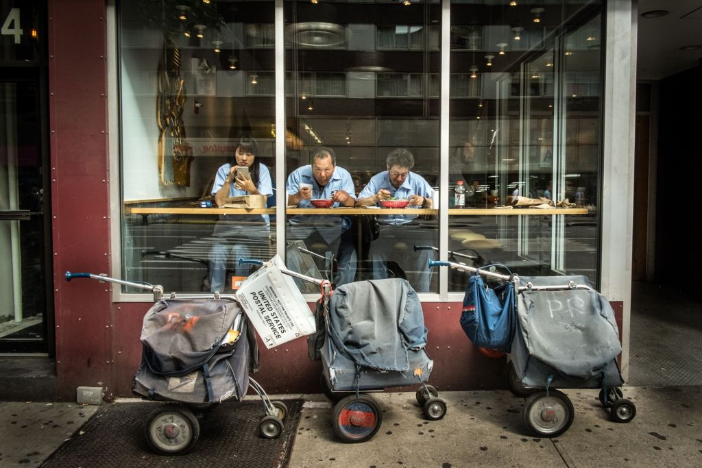 Even mail carriers take a break for lunch; a photograph on display at the Sarona Market exhibit 'Food Processor III' (Courtesy Dan Haimovich)